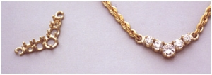 "a10670 14kt Yellow Gold Classic ""V"" Pendant For (1) 5mm (2) 4mm and (2) 3.5mm Round Faceted Gems."